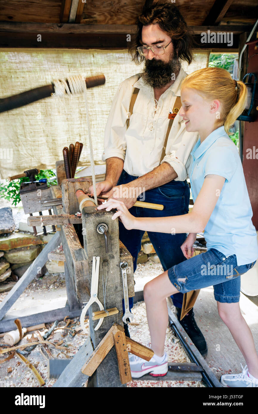Arkansas Ozark Mountains Mountain View Ozark Folk Center State Park Foot Lathe man beard girl teen learn hands on - Stock Image