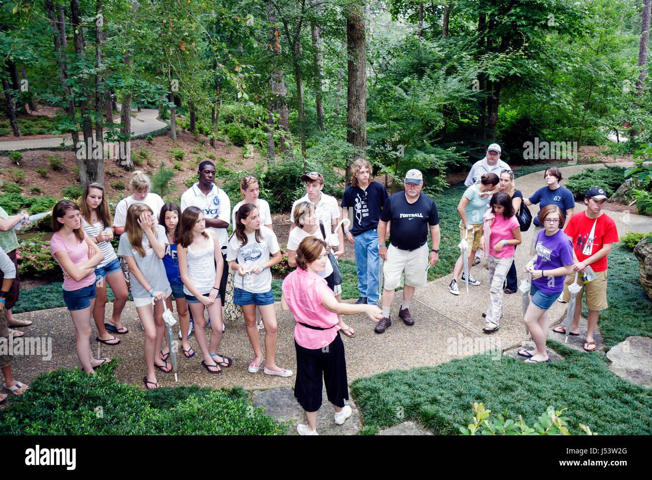 Arkansas Hot Springs Garvan Woodland Gardens tour guide students man men woman boy girl teen student field trip - Stock Image