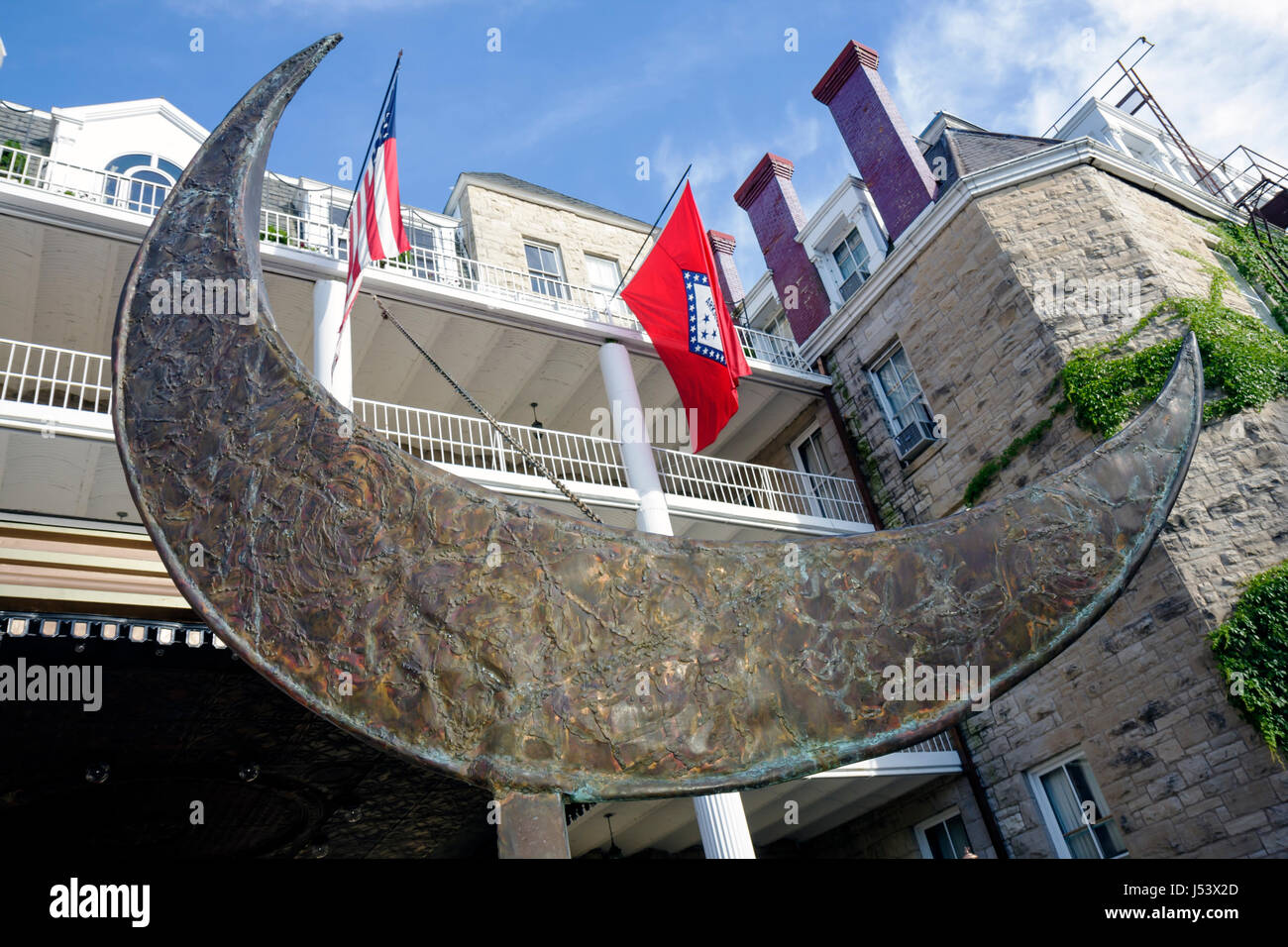 Arkansas Eureka Springs 1886 Crescent Hotel and Spa sculpture entrance lodging historic limestone haunted ghost - Stock Image