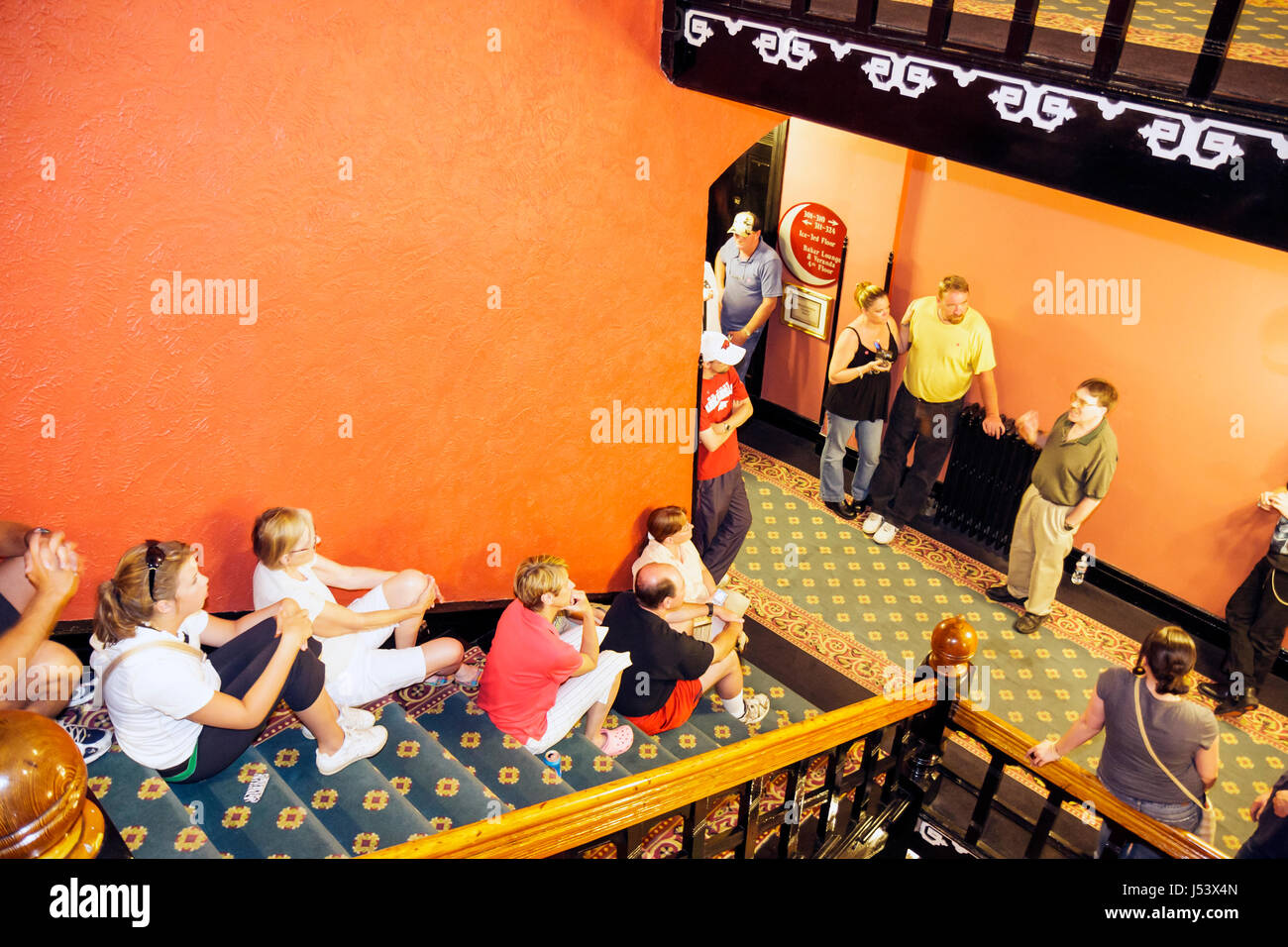 Arkansas Eureka Springs 1886 Crescent Hotel and Spa Ghost Tour stairs hallway stories guide man men woman women - Stock Image