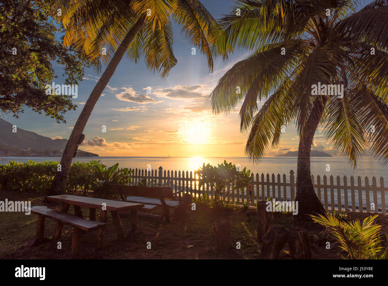 Romantic sunset on the shore of a tropical island - Stock Image