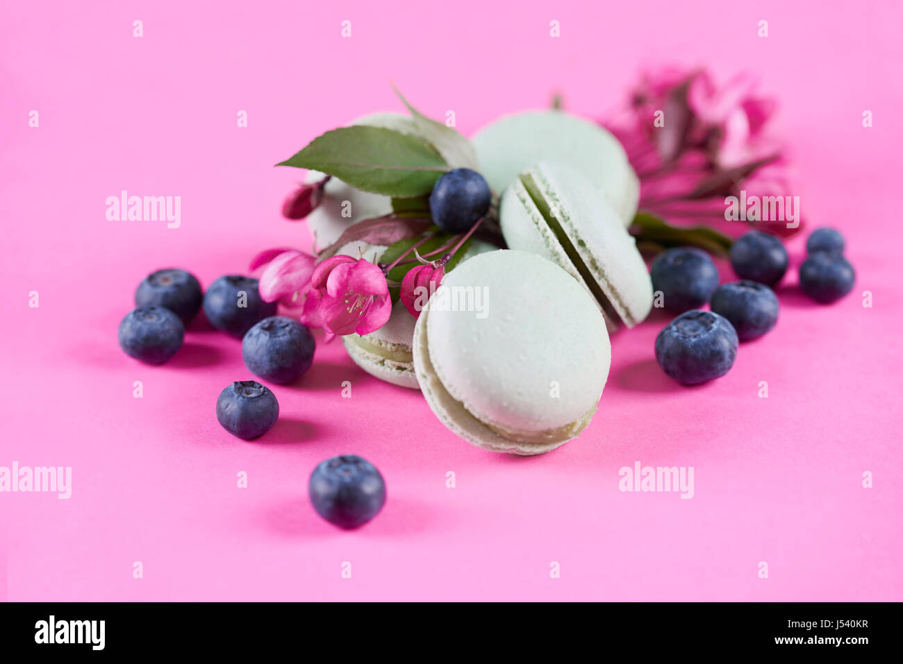 Close up of sweet macaroons with blueberries - Stock Image