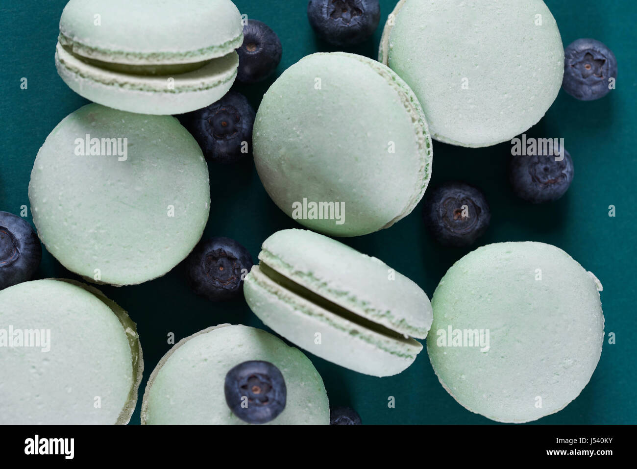 Directly above shot of macaroons with blueberries - Stock Image