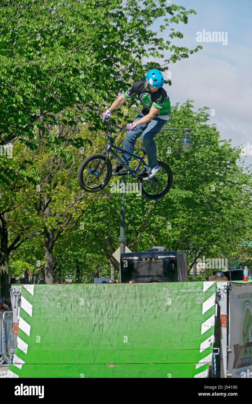 5.14.2017 Stunt bicycle riders performing tricks at the Lubavitch Lag B'Omer parade on Eastern Parkway in Crown - Stock Image