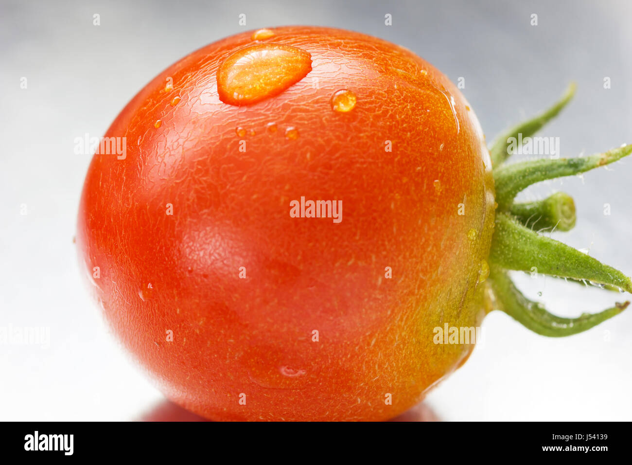 water pearl on red cherry tomato Stock Photo