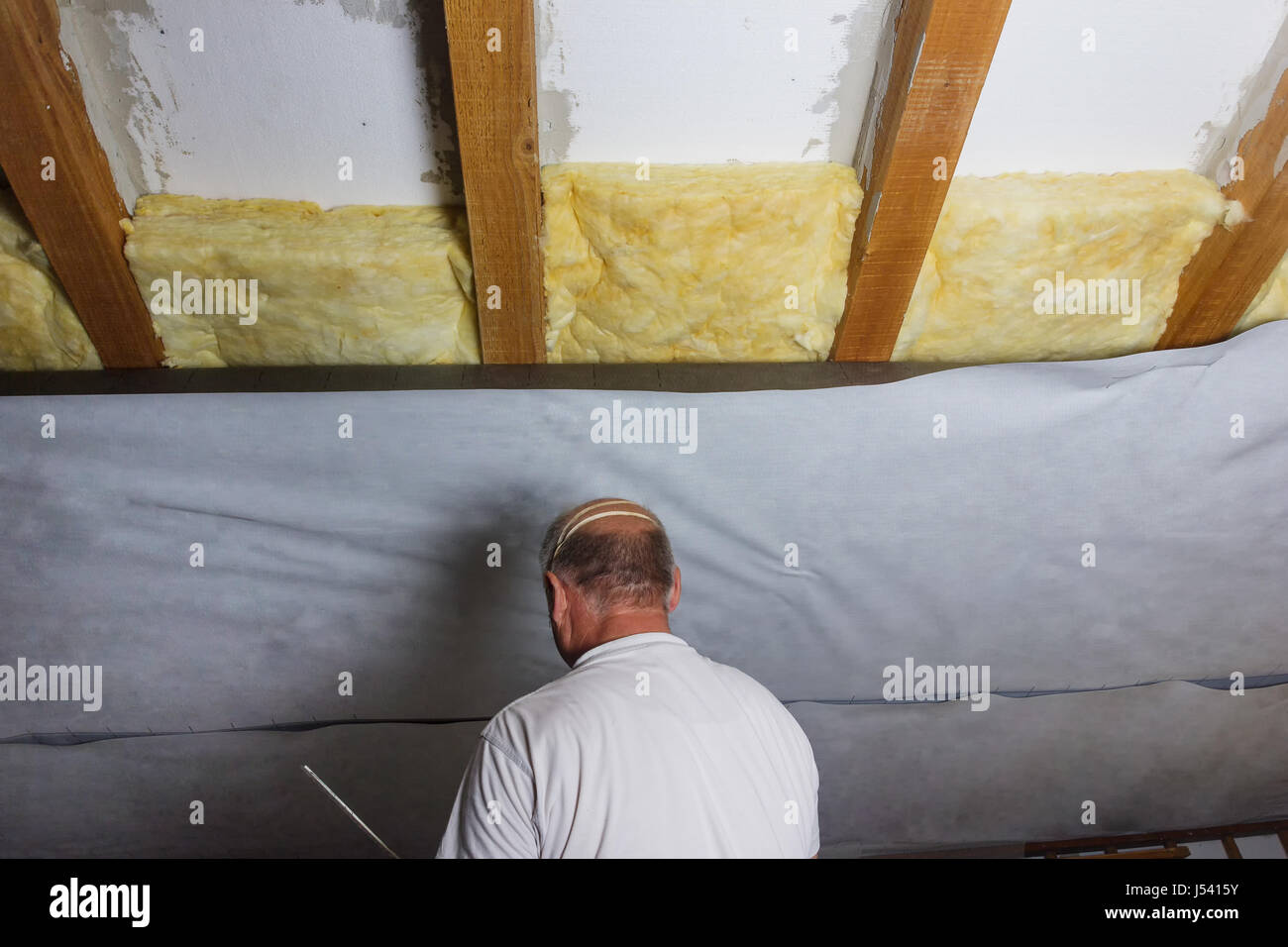 wooden beams of attic with thermal insulation fitting in there and foil & wooden beams of attic with thermal insulation fitting in there and ...
