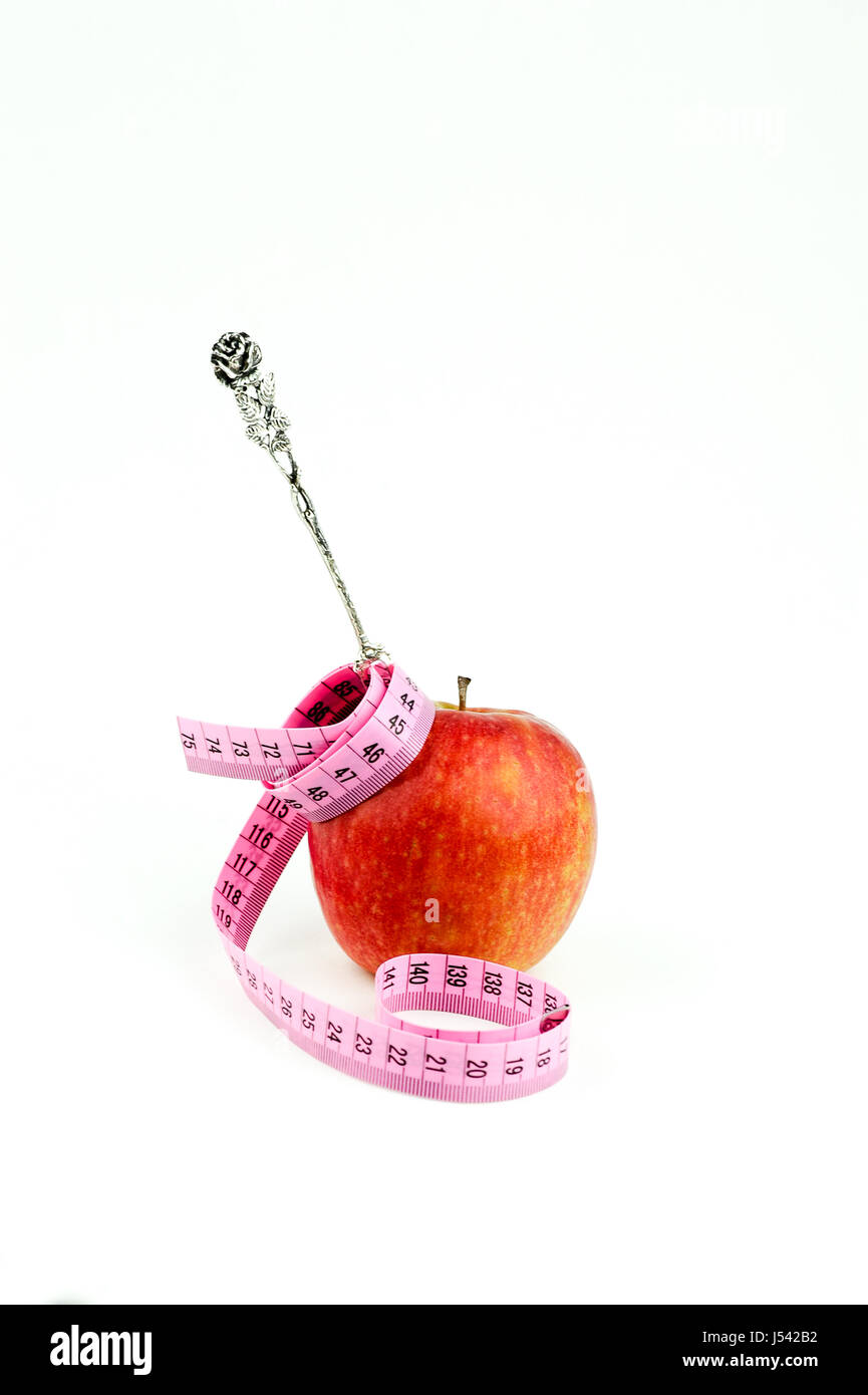 apple with measuring tape and silver fork - Stock Image