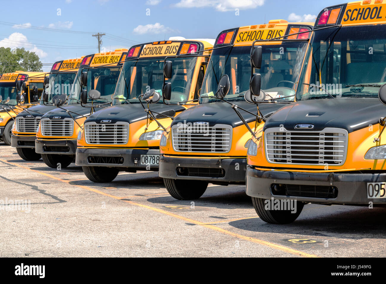 Cincinnati - Circa May 2017: Yellow School Buses in a District Lot Waiting to Depart for Students I Stock Photo
