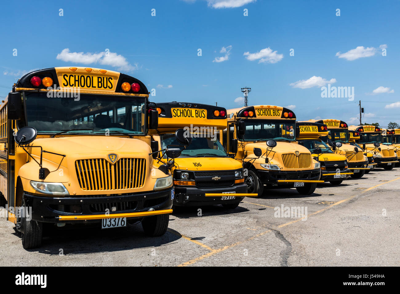 Cincinnati - Circa May 2017: Yellow School Buses in a District Lot Waiting to Depart for Students III Stock Photo