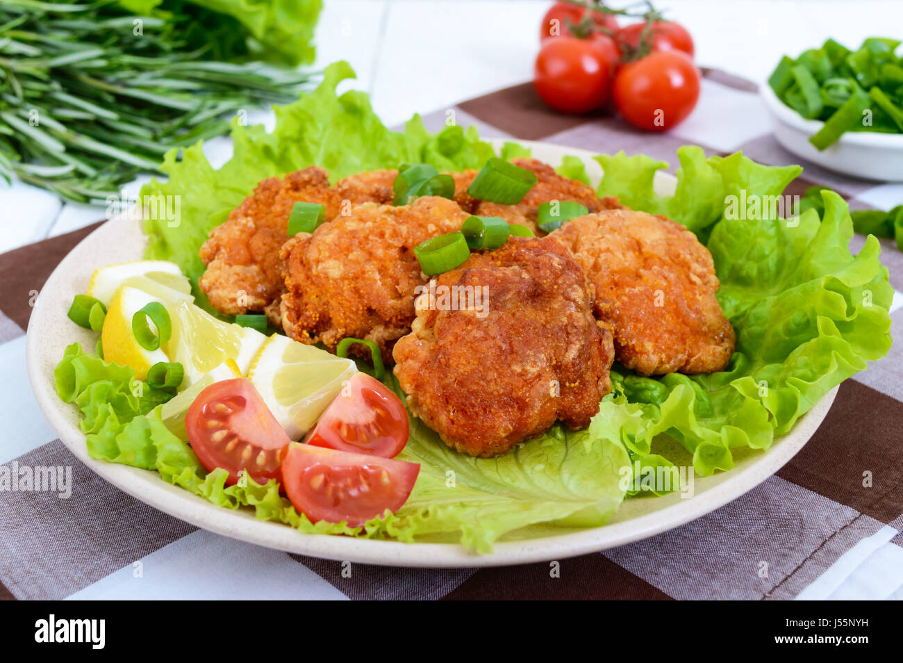 Fried caviar of river fish with lettuce leaves, cherry tomatoes on a light background. A dietary dish. Healthy eating. - Stock Image