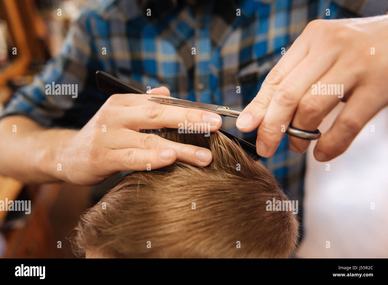Ends of the hair being cut by a professional hairdresser - Stock Image