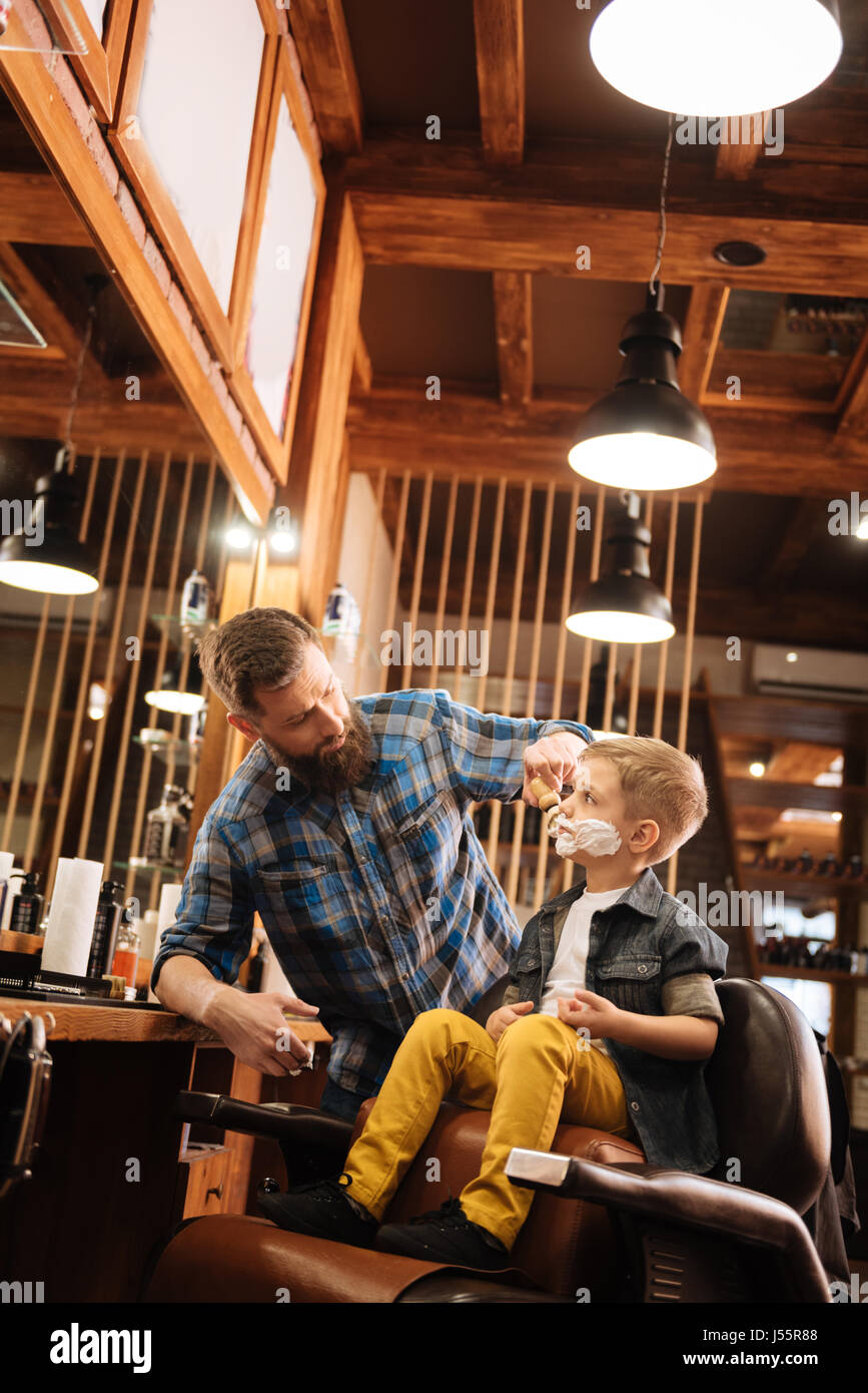 Nice professional man working in the barbershop - Stock Image