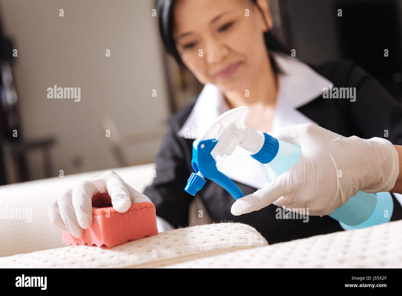 Selective focus of a sponge and cleansing agent - Stock Image