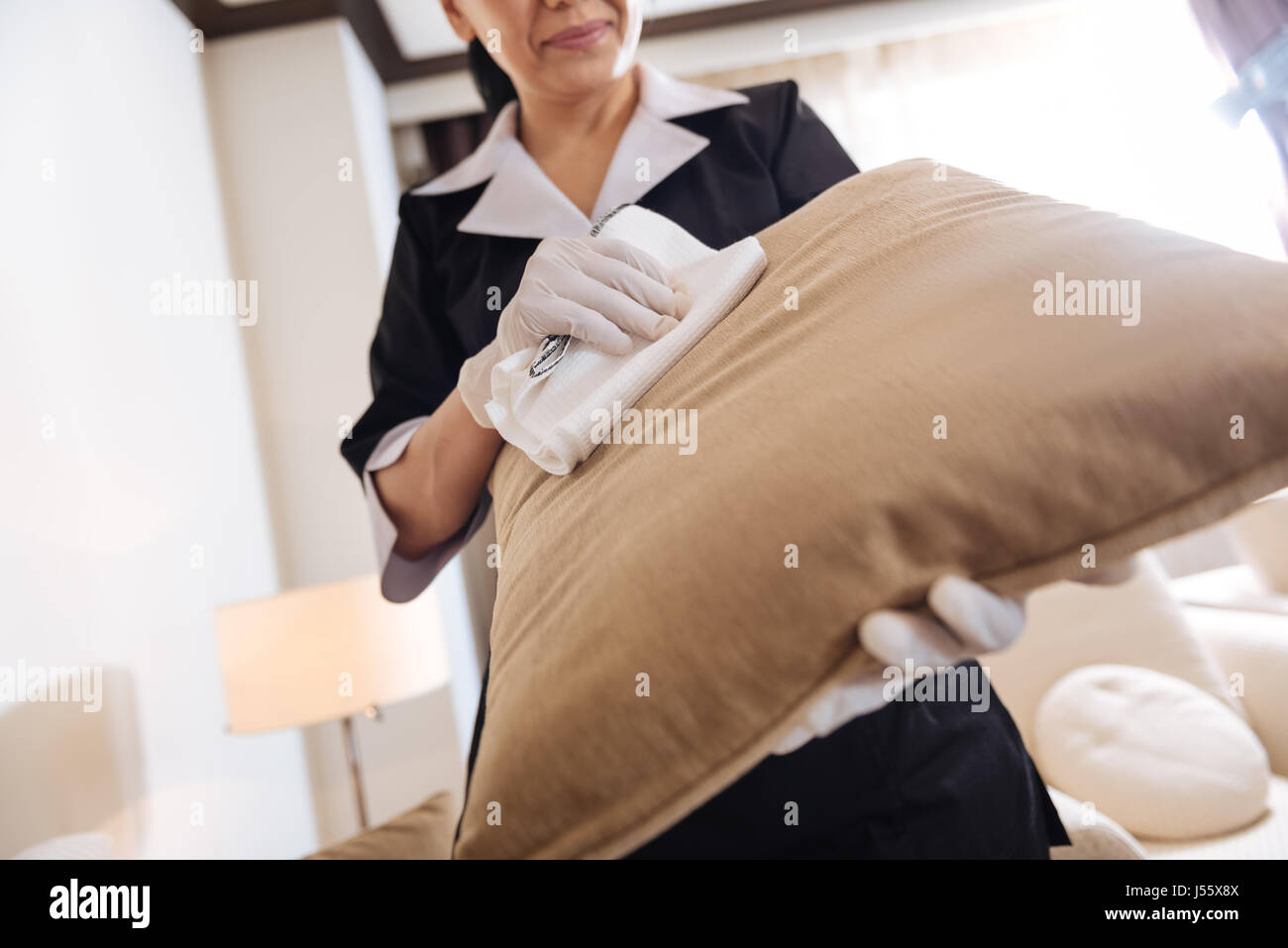 Close up of a sofa cushion being cleaned - Stock Image