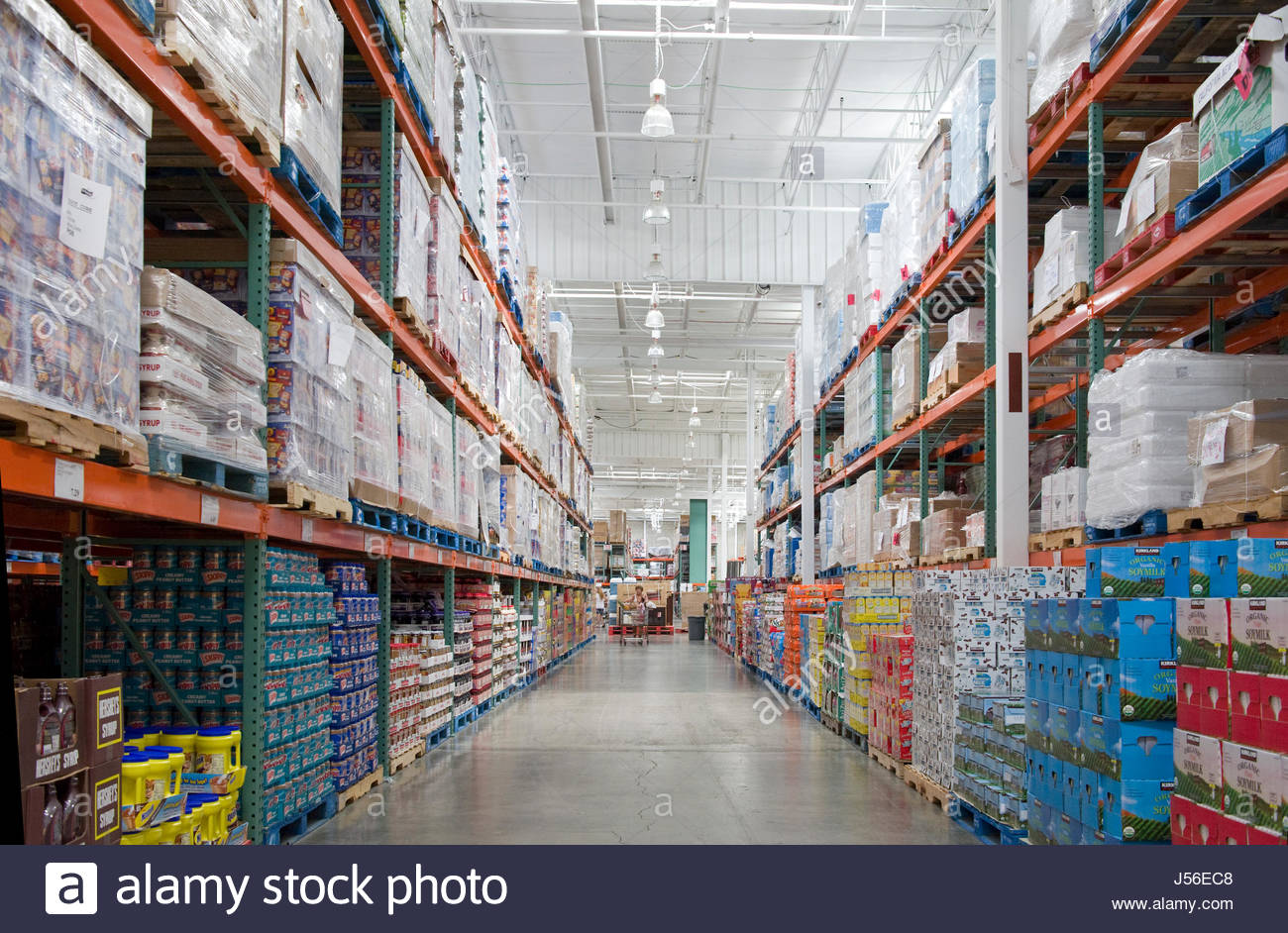 Products In Bulk On Wooden Pallets Stack High On Metal Shelves At