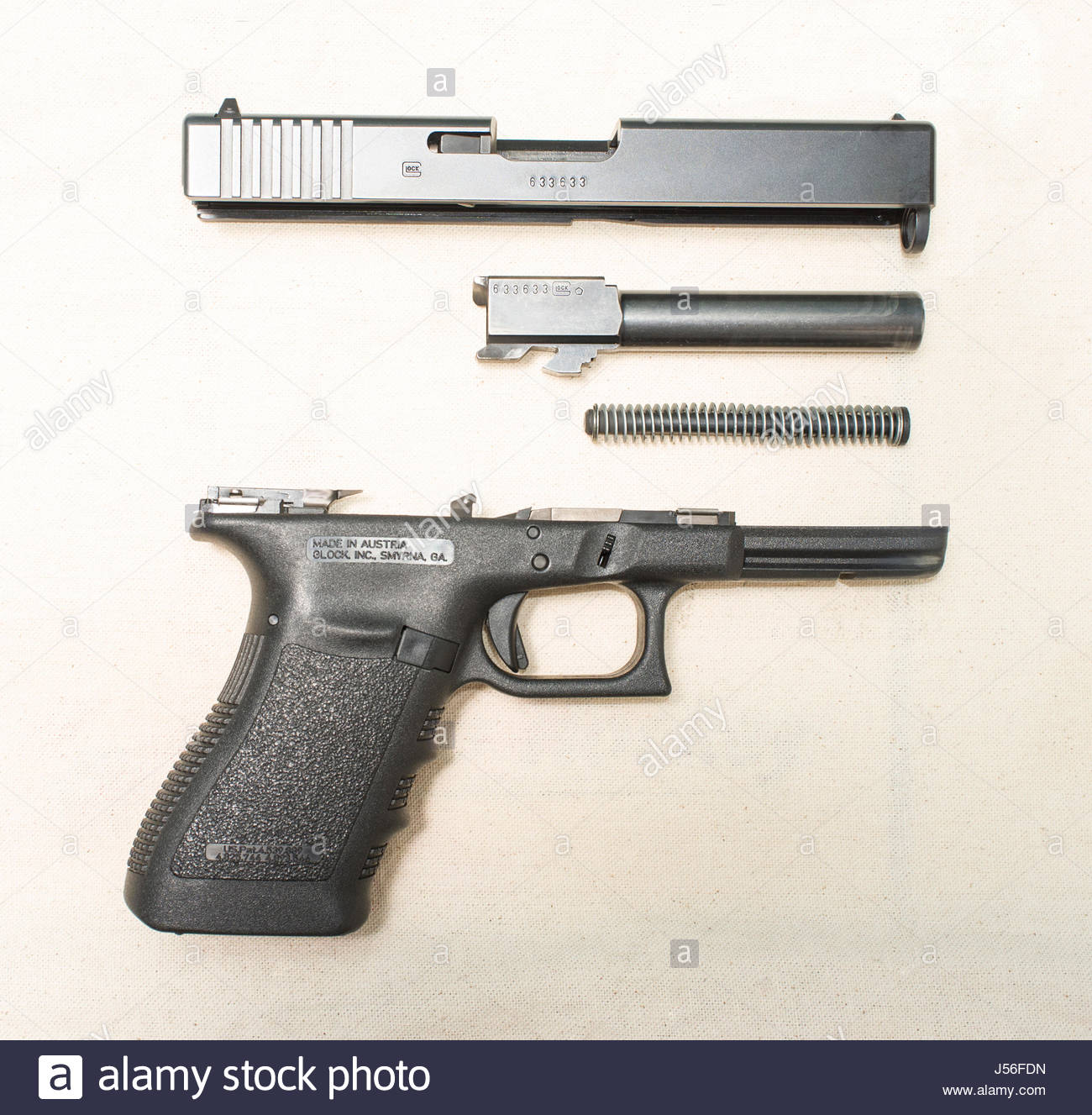 Parts of a disassembled Glock 21 semi auto pistol in  45 ACP caliber