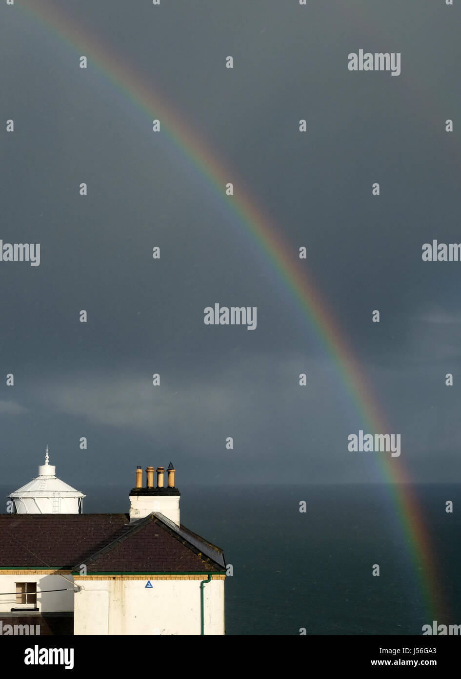 Rainbows over Blackhead Lighthouse. - Stock Image