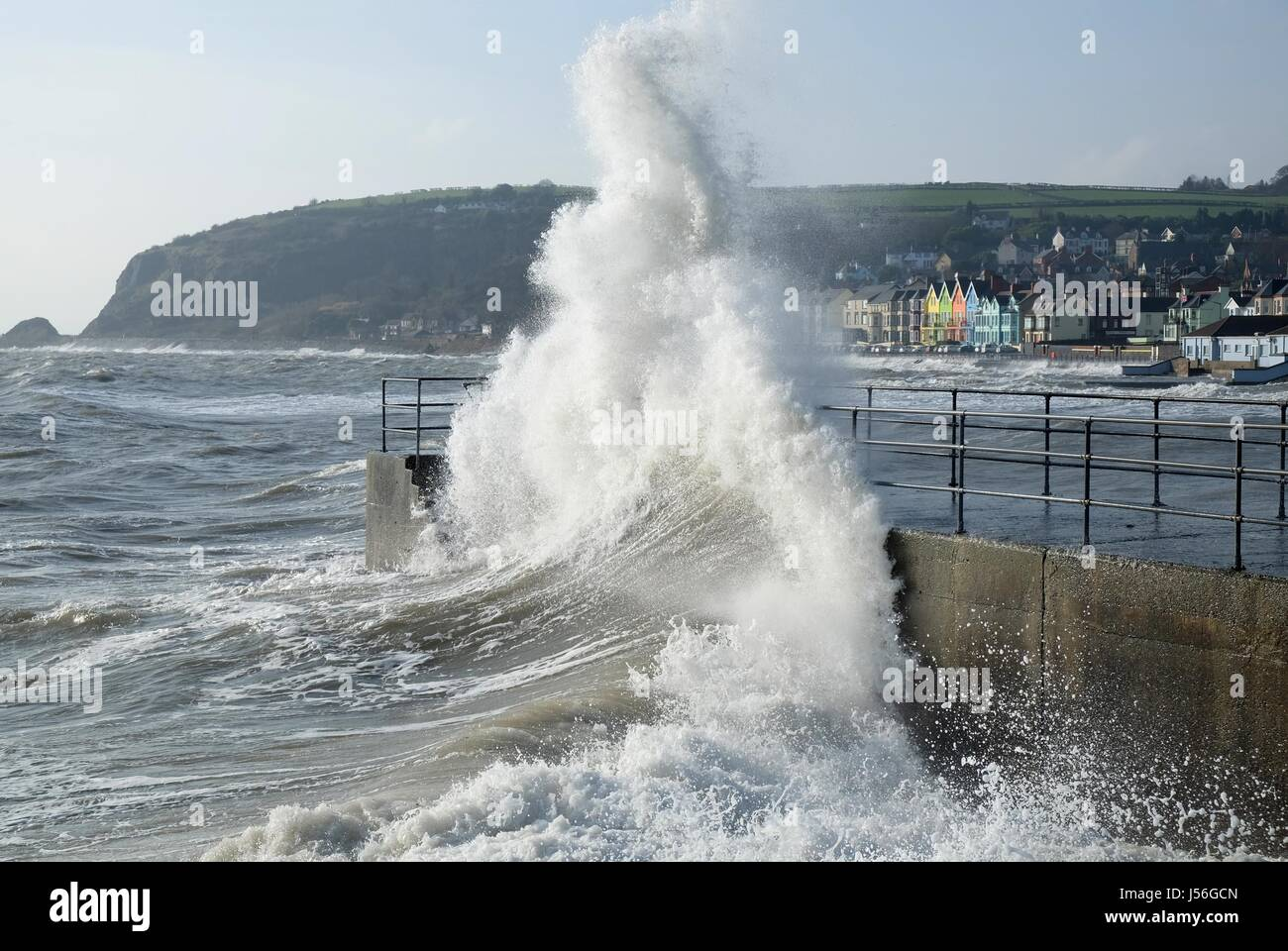 Wave breaking on pier at Whitehead, Northern Ireland - Stock Image