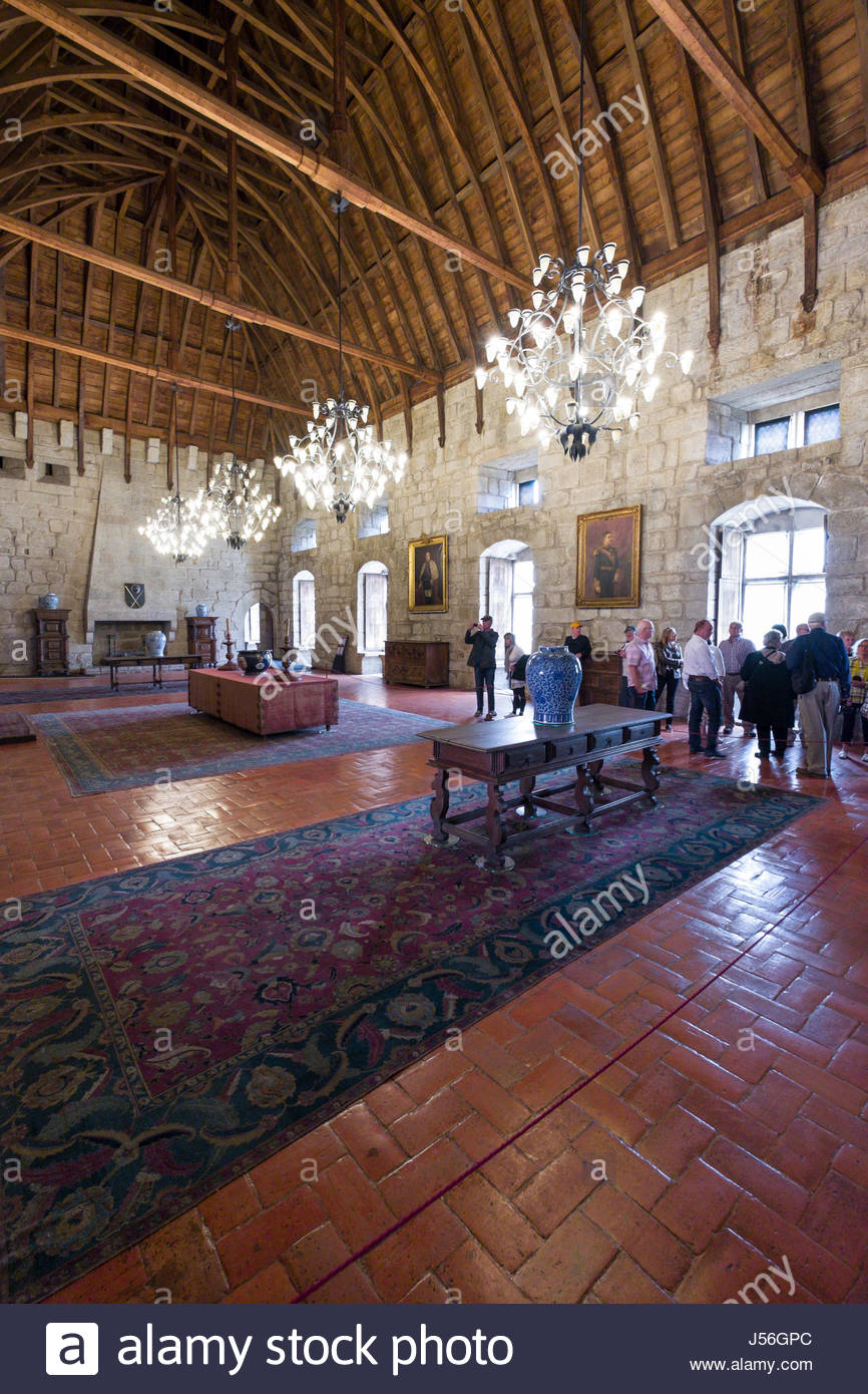 Group of people touring an interior room in the Palace of the Dukes of Braganza, Guimarães, Ave, Norte, Portugal - Stock Image