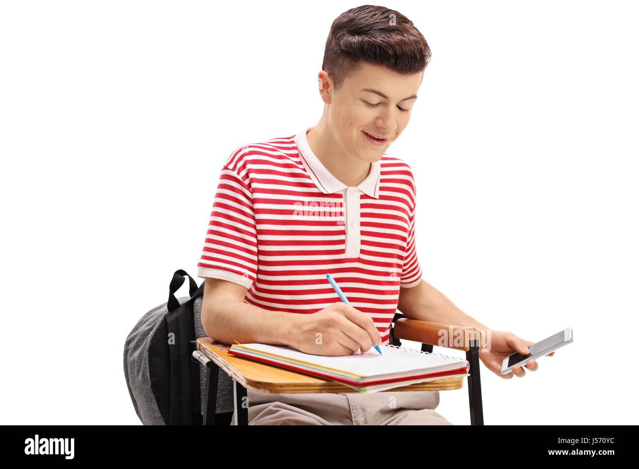 Teen student cheating on a test with a phone isolated on white background - Stock Image