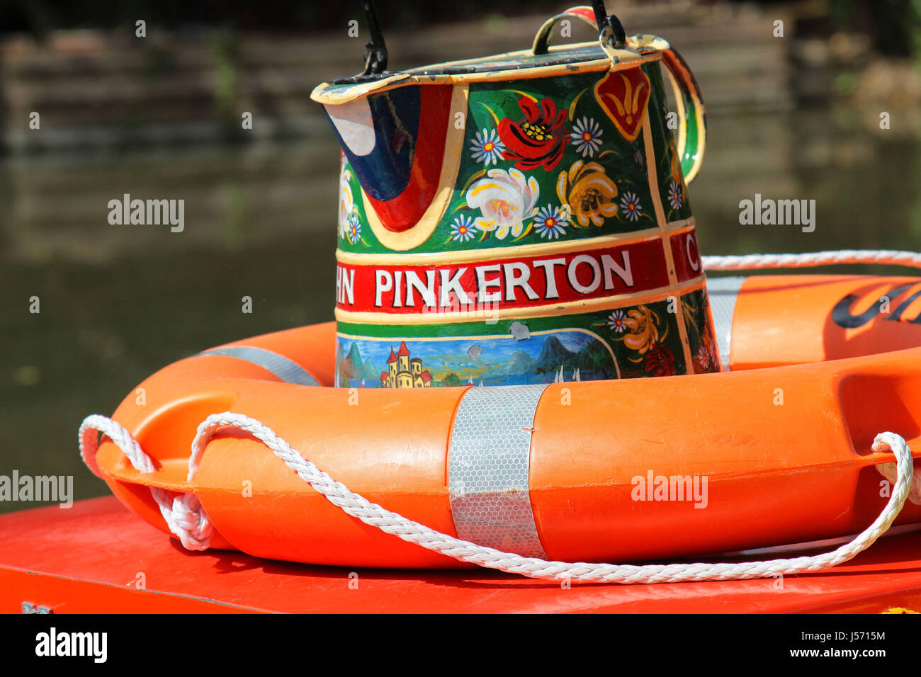 Decorated jug on canal boat, Basingstoke Canal, Odiham, Hampshire UK - Stock Image
