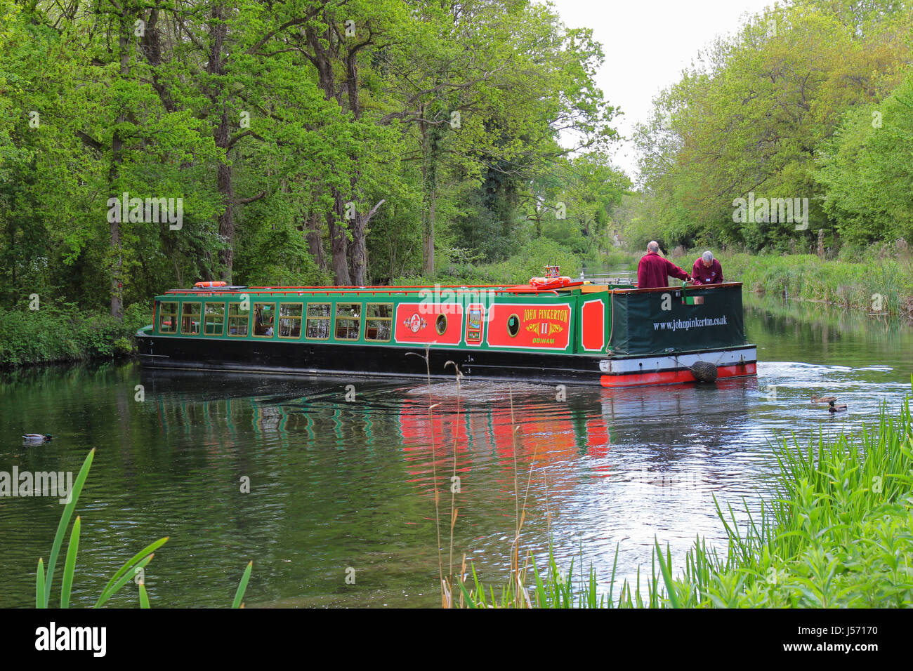 Turning a canal boat on the Basingstoke Canal, Odiham, Hampshire UK - Stock Image