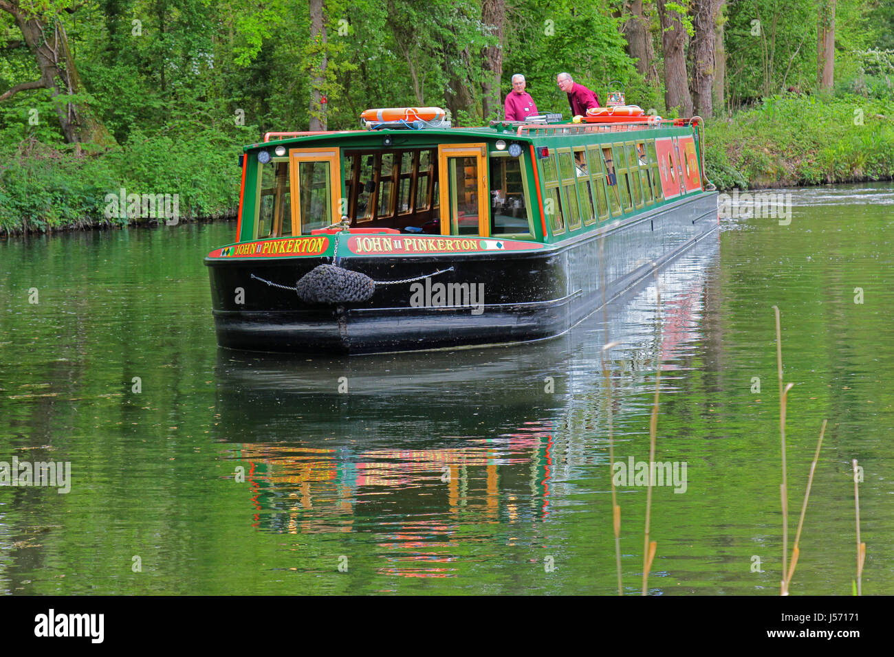 Head on shot of a canal boat on the Basingstoke Canal, Hampshire, UK - Stock Image