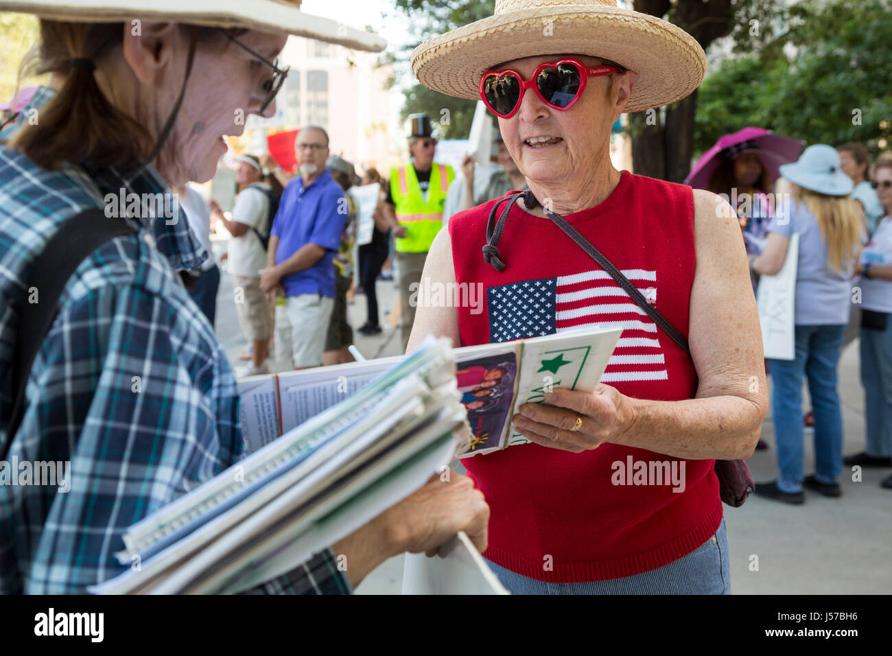 Tucson, Arizona - A woman circulates a petition supporting pre-school programs for kids. - Stock Image