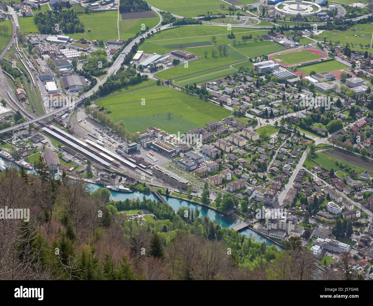 Switzerland Interlaken and Interlaken Ost station from Harder Kulm with the river Aare between the two lakes Brienz - Stock Image