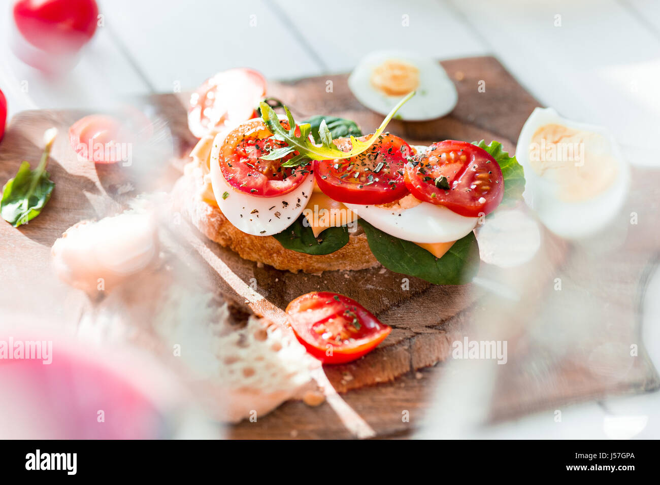 The baguette and cheese on wooden background - Stock Image