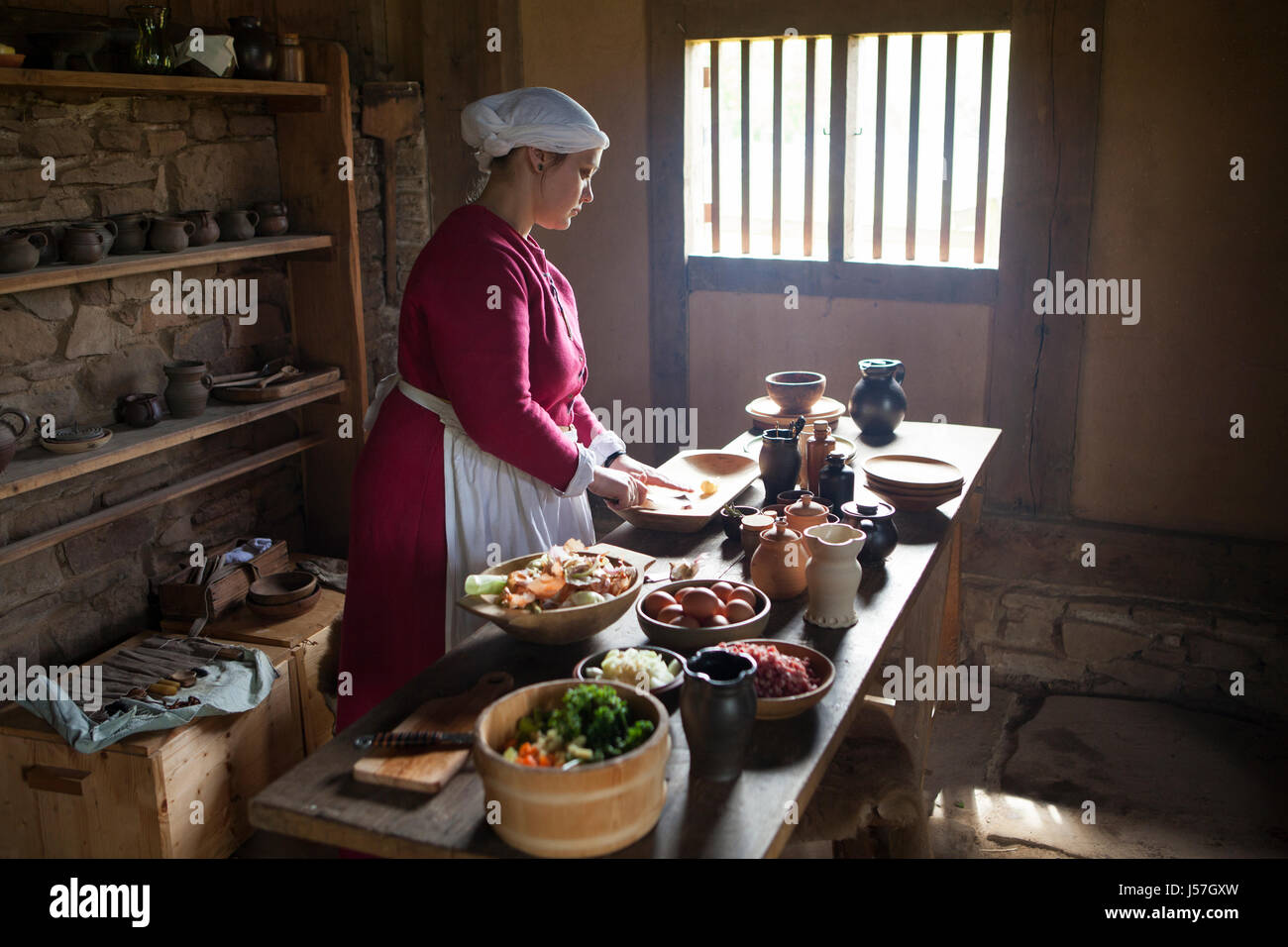 Cooking by a reenactment group, reconstructed medieval house, Nienover, Bodenfelde, Lower Saxony, Germany - Stock Image