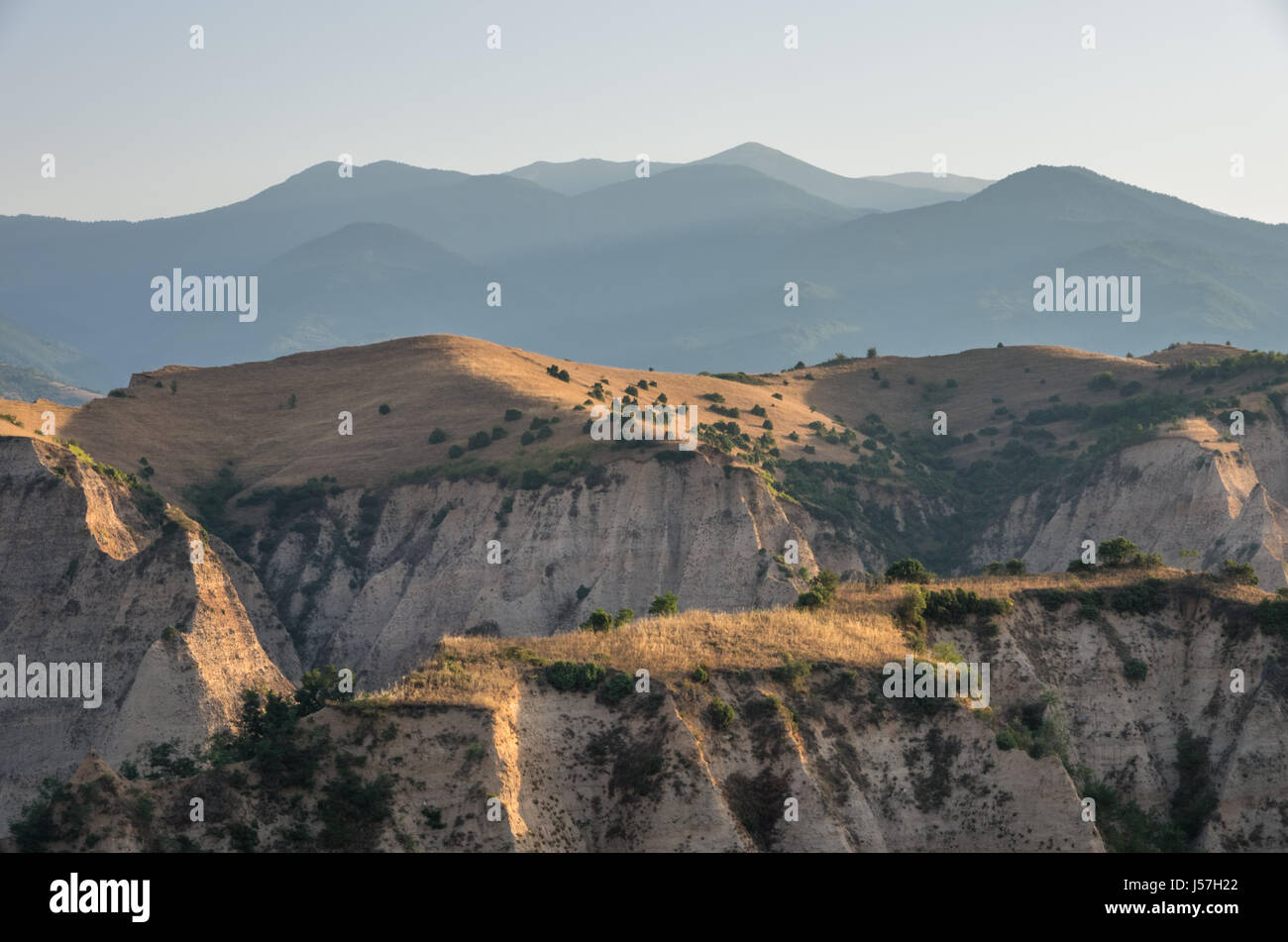 Morning light over Sand Pyramids near Melnik with Pirin Mountains in the horizon, Bulgaria. - Stock Image