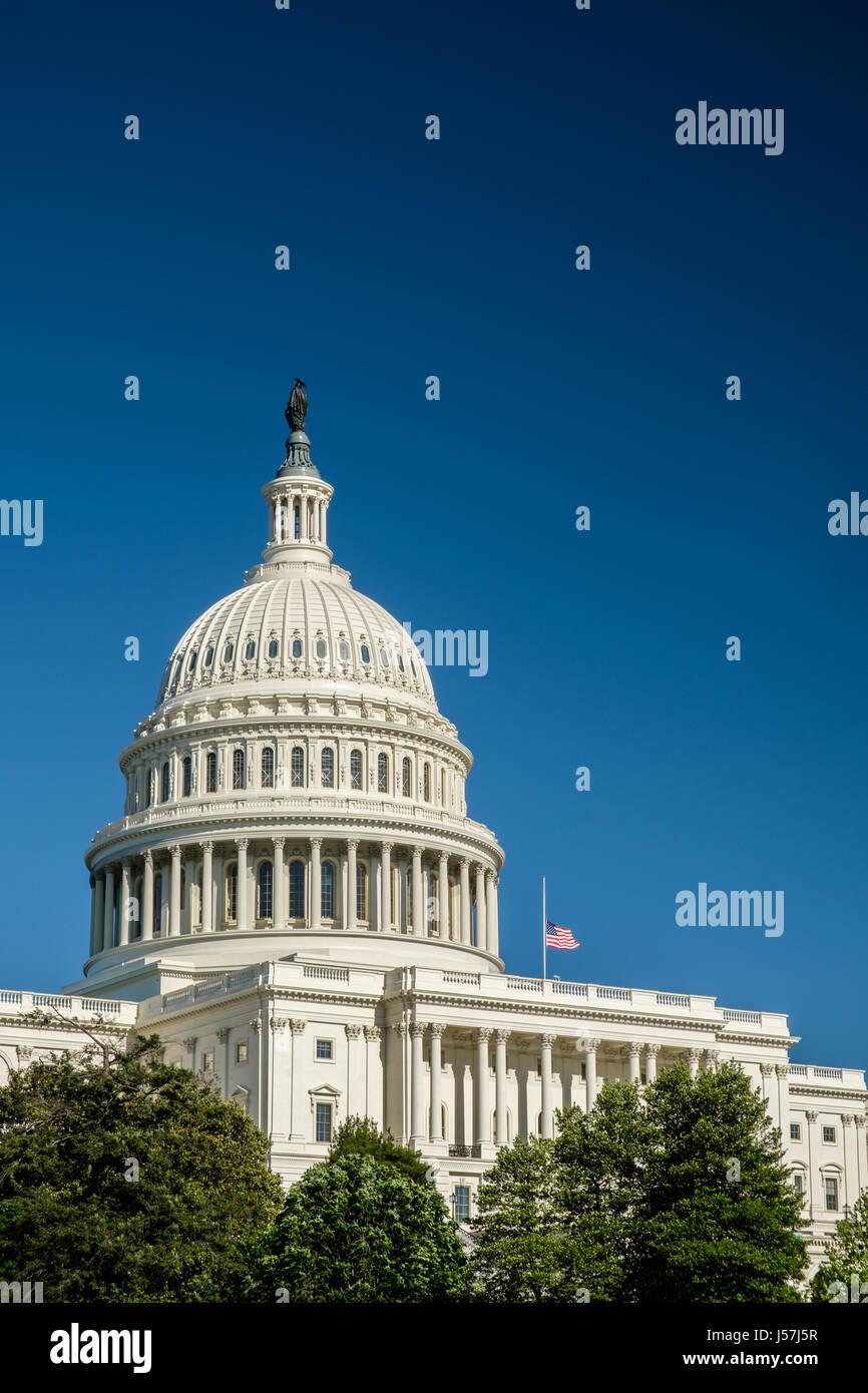 Profile of U.S. Capitol with Flag at Half-Mast, Washington, DC - Stock Image