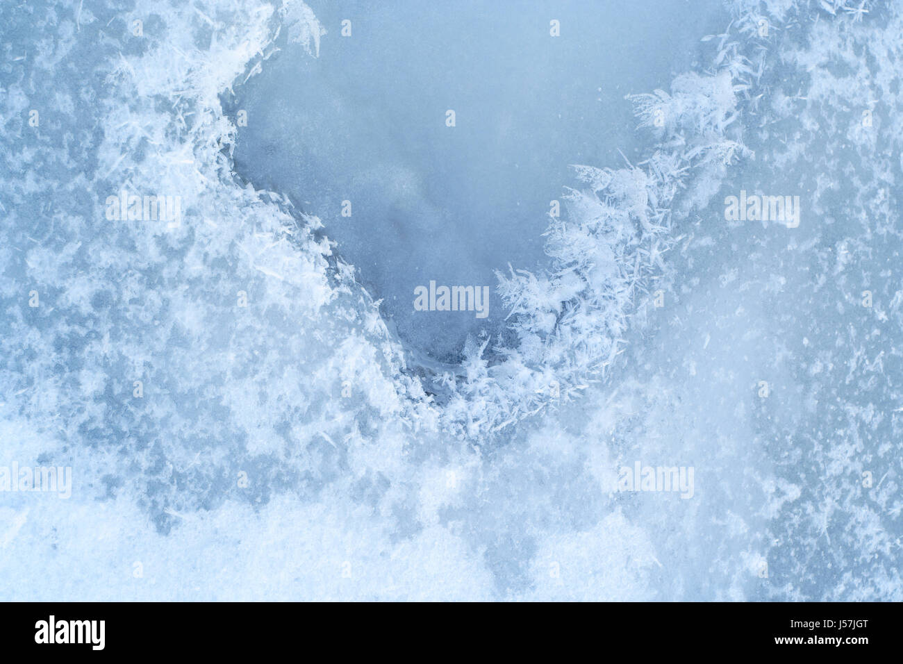 Close-up ice-bound water surface with crystals pattern at the winter time. Stock Photo