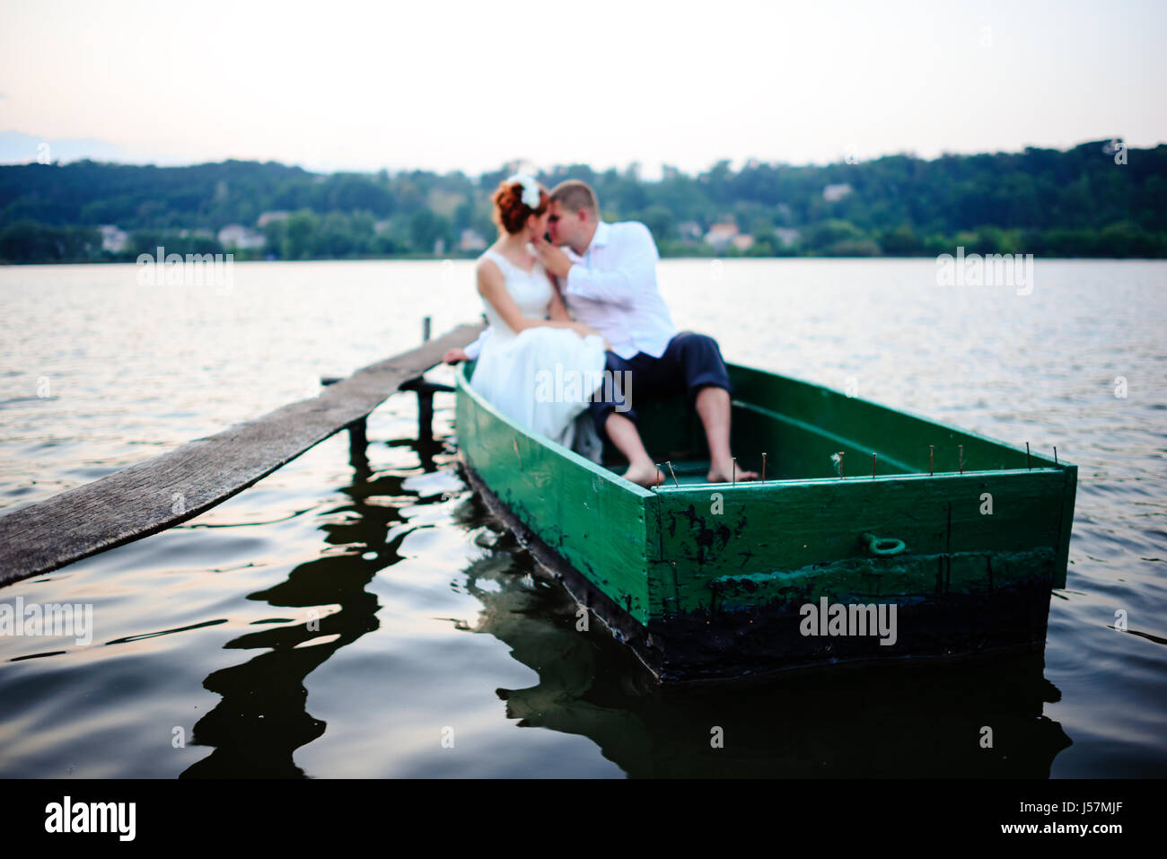 Young couple in love on sail boat having fun with tablet - Happy luxury lifestyle on yacht sailboat - Always connected - Stock Image