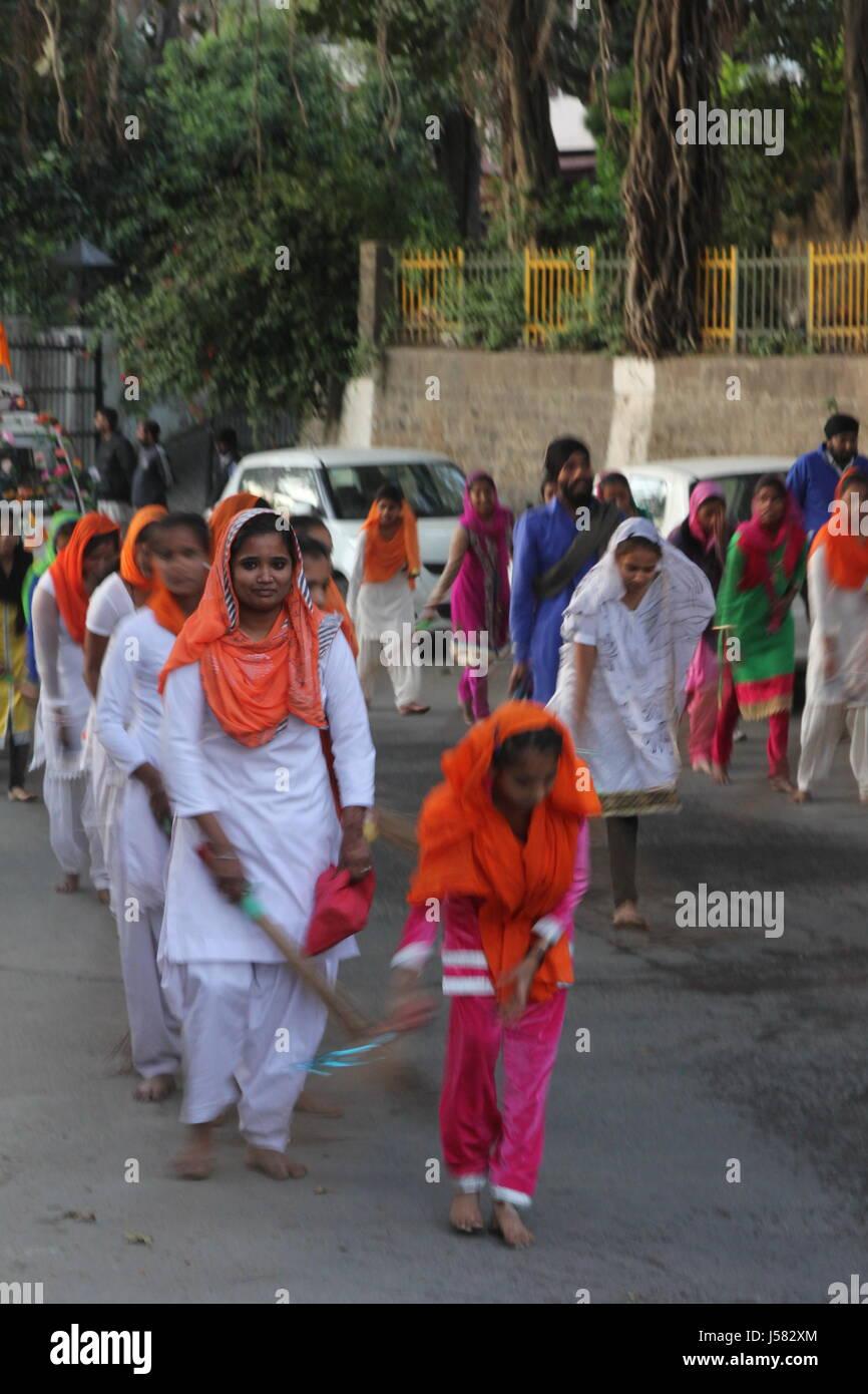 local women sweeping floor in group in Himachal Pradesh, north India - Stock Image
