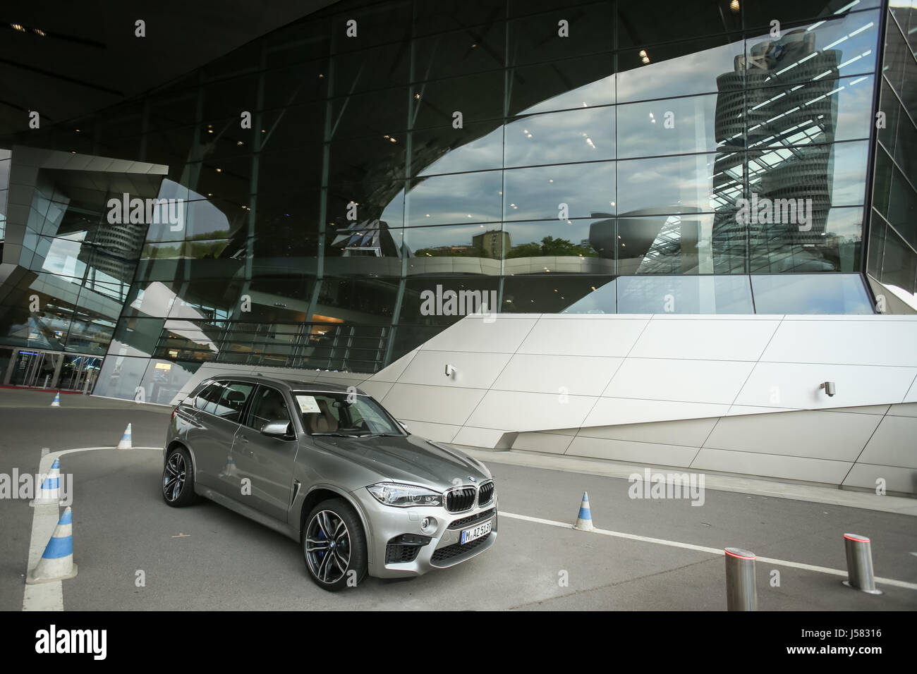 MUNICH, GERMANY - MAY 6, 2017 : A view of the BMW X5 SUV automobile exhibited in front of the BMW Welt exhibition - Stock Image