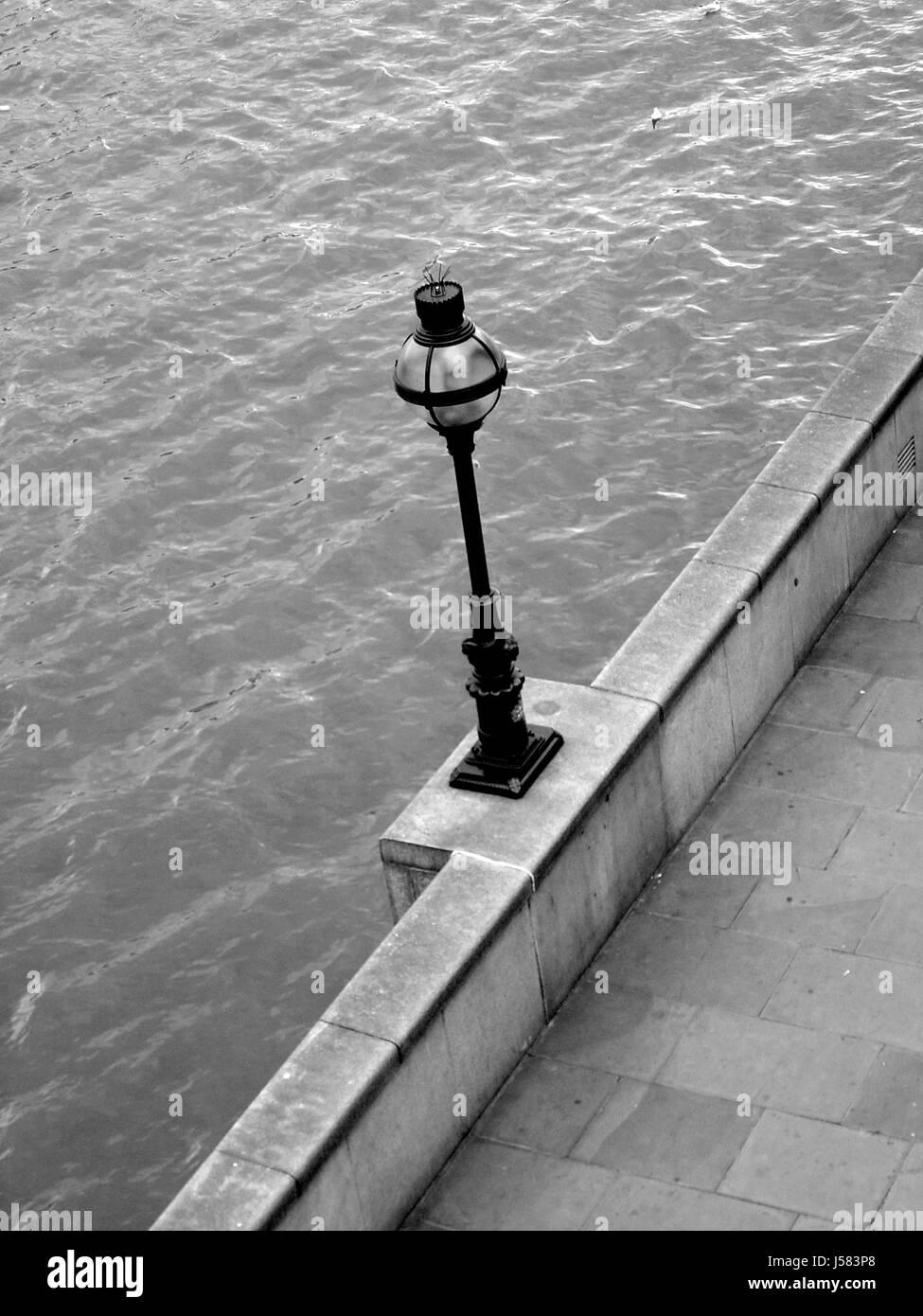 stone,bw,london,england,thames,shiner,light,lamp,luminary,day,water - Stock Image
