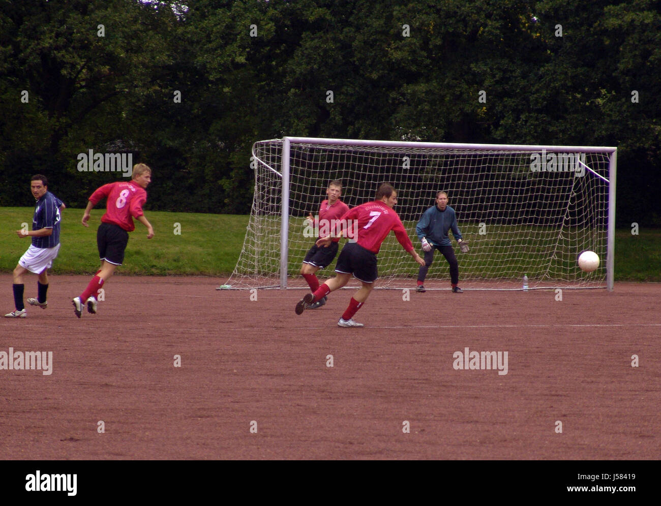 men man ball fight fighting perseverance angular training fellowship sport - Stock Image