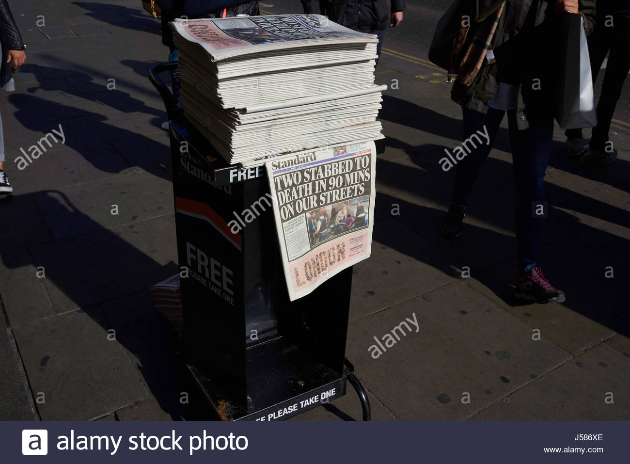 London Evening Standard  Free Newspaper on a stand with headline Two Stabbed to death in 90 mins on our streets - Stock Image