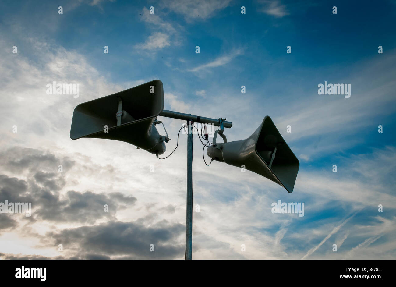 Public Address System against a blue sky - Stock Image