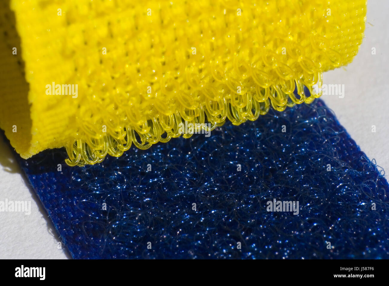 blue fortification velcro fastener outfit yellow clothes clothing 165 - Stock Image