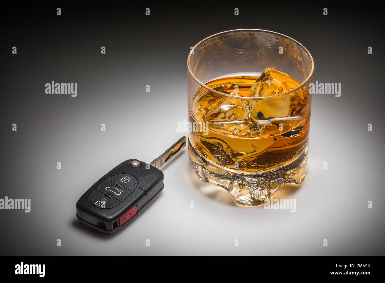 Drinking and driving concept with whiskey and car keys Stock Photo