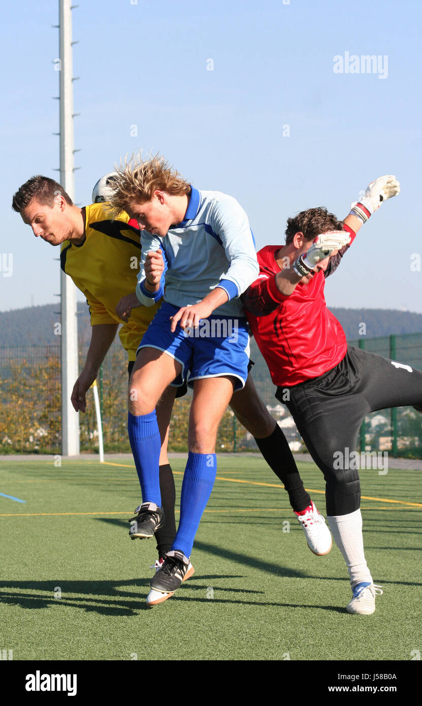 in three-way battle for the header - Stock Image
