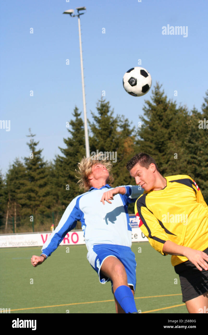 men man sport sports game tournament play playing plays played ball fight - Stock Image