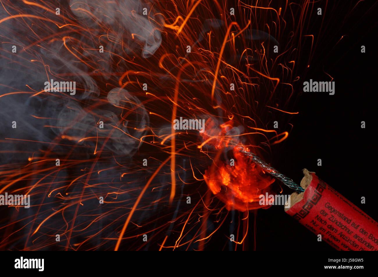 fire conflagration silvester bang saluting gun clacker slow match firework Stock Photo
