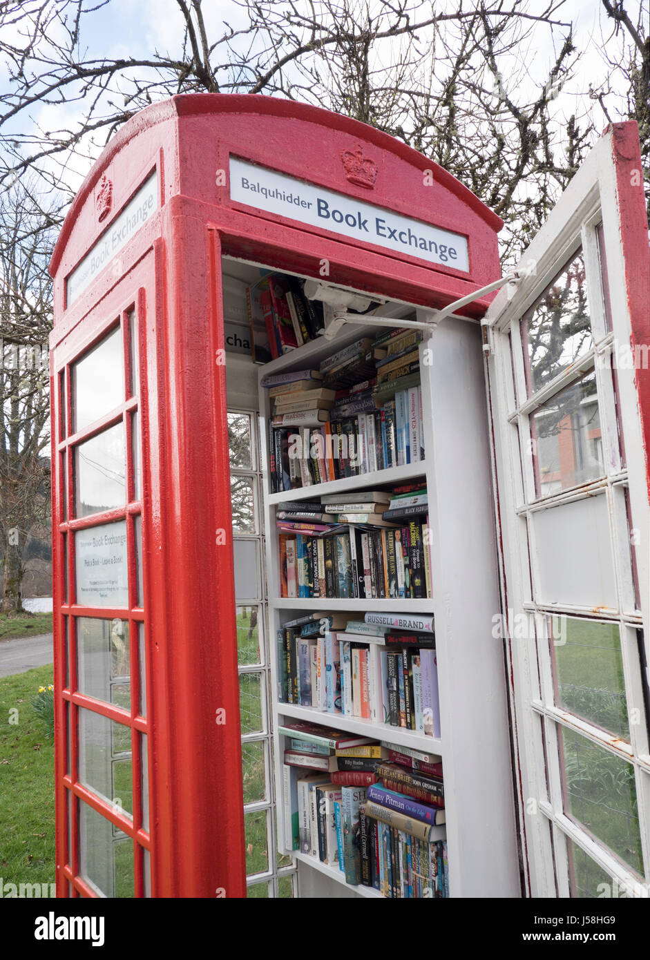 Balquhidder Book Exchange in an old red telephone kiosk, Balquhidder, Perthshire, Scotland - Stock Image