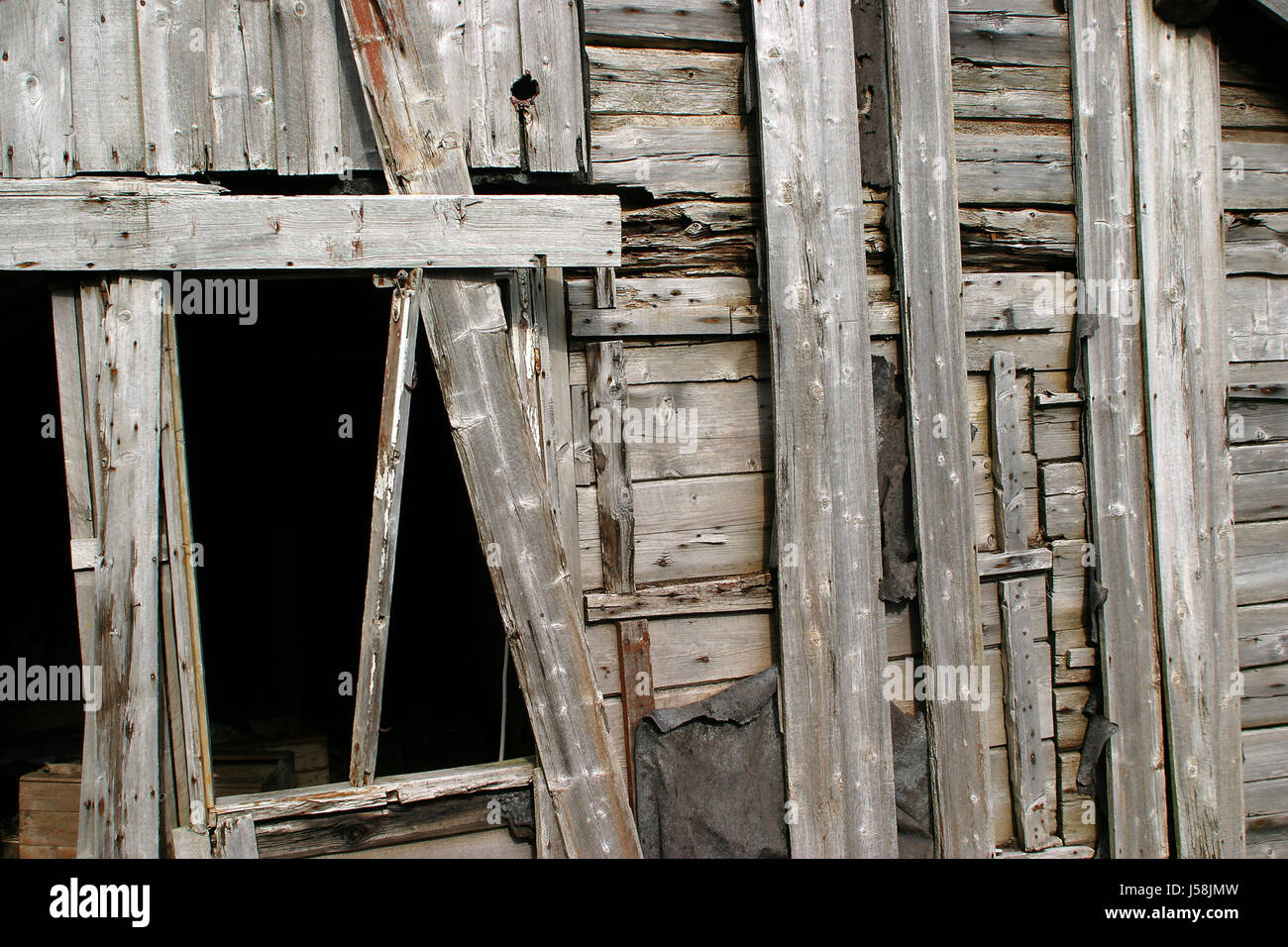 framehouse hovel rotten canvas blowzed boarding building material expiry date Stock Photo