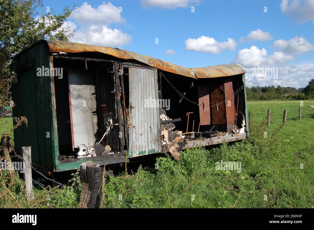 location shot rust rusted decompose sunshine caravan caravans weatherworn - Stock Image