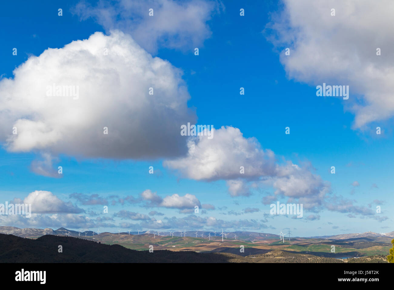 Windmills producing electrical energy near Ardales, Malaga Province, Andalusia, southern Spain. - Stock Image